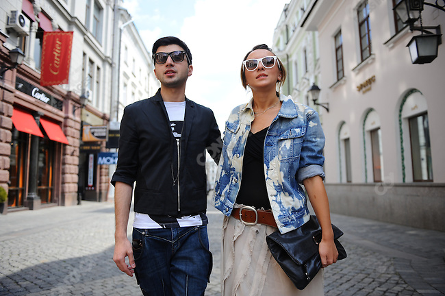 Alesia Matiashuk, 26, designer, with Yury Yu, make-up artist on Stoleshnikov Pereyulok, Moscow, Russia, July 12, 2009