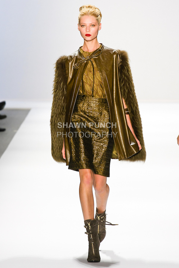 Vika Falileeva walks the runway in a Luca Luca Fall 2011 outfit, designed by Raul Melgoza, during Mercedez-Benz Fashion Week, February 10, 2011