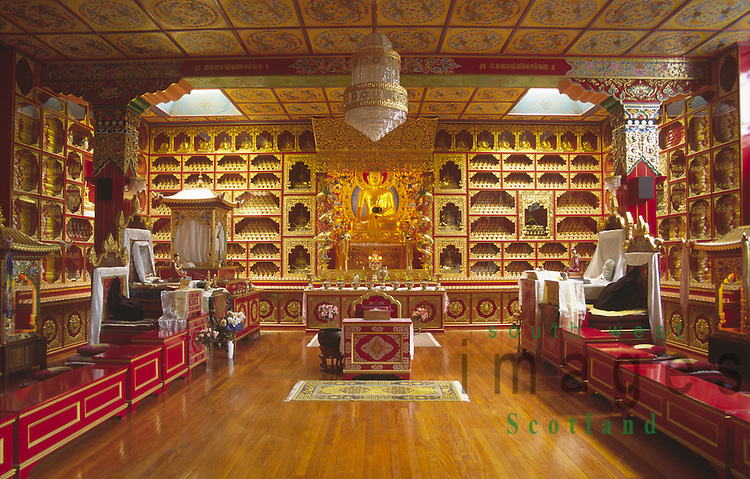 Inside Kagyu Samye Ling monastry and Tibetan Centre near Langholm gold buddha and other elaborate decorations inside temple Dumfries and Galloway Scotland UK
