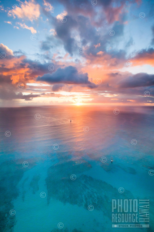 An aerial view of an epic sunset in front of Waikiki, Honolulu, O'ahu.