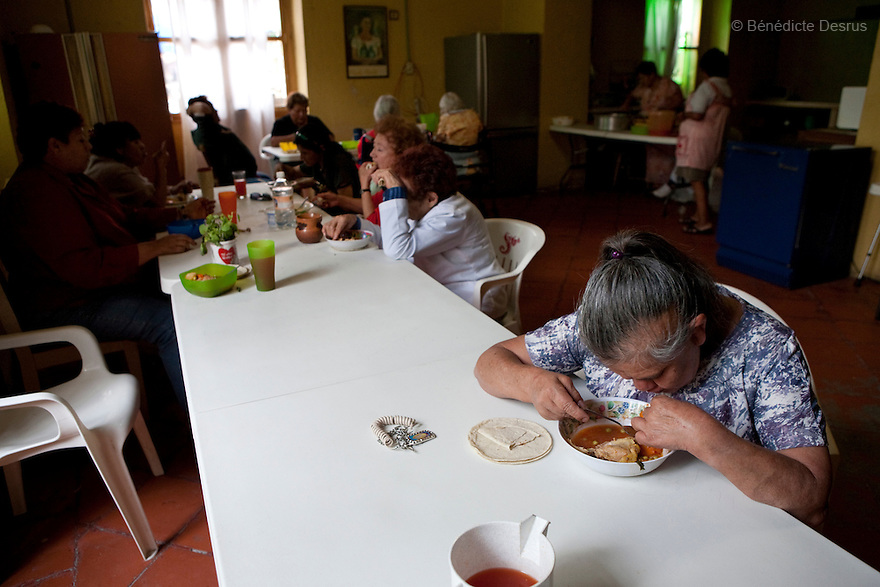 Residents of Casa Xochiquetzal during lunch time at the shelter in Mexico City, Mexico on July 28, 2008. Casa Xochiquetzal is a shelter for elderly sex workers in Mexico City. It gives the women refuge, food, health services, a space to learn about their human rights and courses to help them rediscover their self-confidence and deal with traumatic aspects of their lives. Casa Xochiquetzal provides a space to age with dignity for a group of vulnerable women who are often invisible to society at large. It is the only such shelter existing in Latin America. Photo by Bénédicte Desrus