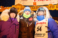 Three Norwegian mushers Ketil Reitan, Joar Leifseth Ulsom and Geir Idar Hjelvik at the finish line in Nome after Geir arrived in 45th place during the 2017 Iditarod on Friday March 17, 2017.<br /> <br /> Photo by Jeff Schultz/SchultzPhoto.com  (C) 2017  ALL RIGHTS RESERVED