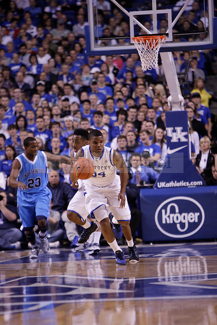 Senior Guard Juilus Mays runs the ball up the court during the first half of the University of Kentucky vs. Northwood Basketball exhibition game at Rupp Arean in Lexington, Ky., on, {November} {1}, {2012}. Photo by Jared Glover | Staff