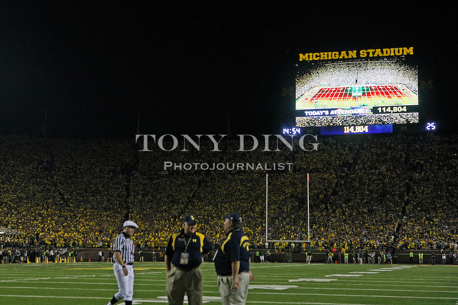 A record 114,804 attended the first ever night-time NCAA college football game at Michigan Stadium between Michigan and Notre Dame, Saturday, Sept. 10, 2011, in Ann Arbor. Michigan won 35-31. (AP Photo/Tony Ding)