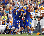 BROOKINGS, SD - SEPTEMBER 14:  Chase Douglas # 93 from South Dakota State University celebrates a fumble recovery against Southeastern Louisiana in the second quarter of their game Saturday night at Coughlin Alumni Stadium in Brookings. (Photo by Dave Eggen/Inertia)