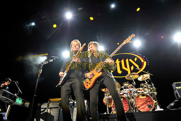 Styx - James Young & Ricky Phillips.Styx performing live at Wembley Arena, London, England..June 4th, 2011.stage concert live gig performance music full suit length black  jacket guitar.CAP/MAR.© Martin Harris/Capital Pictures.