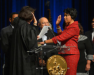 January 2, 2013  (Washington, DC)  Ward 4 D.C. Council member Muriel Bowser (right) takes the oath of office during her swearing-in ceremony at the Washington Convention Center January 2, 2013.  (Photo by Don Baxter/Media Images International)