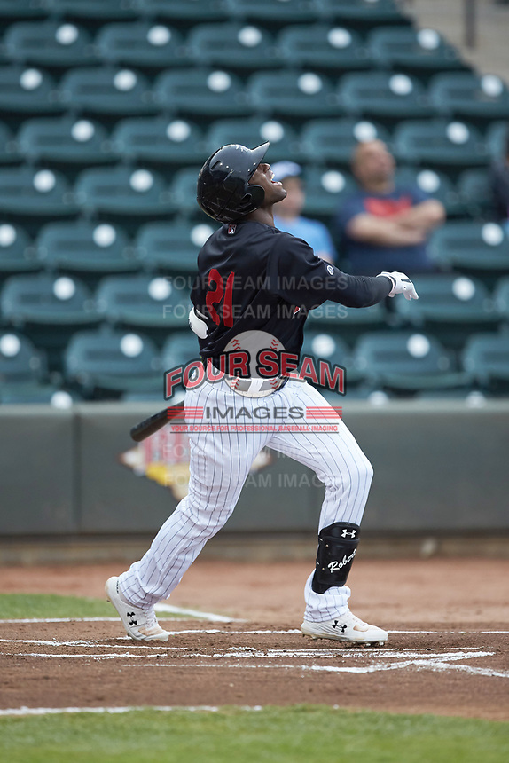 Luis Robert (21) of the Winston-Salem Dash follows through on his swing against the Wilmington Blue Rocks at BB&T Ballpark on April 17, 2019 in Winston-Salem, North Carolina. The Blue Rocks defeated the Dash 2-1. (Brian Westerholt/Four Seam Images)