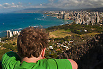 Young boy at the top of Diamond Head Crater Park, looking out toward Honolulu, Oahu, Hawaii