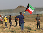 Palestinian protesters clash with Israeli troops following the tents protest where Palestinians demand the right to return to their homeland at the Israel-Gaza border, east of Gaza city, June 28, 2019. Israel agreed to send diesel fuel to the Gaza power plant, expand the fishing zone to 15 nautical miles and return to Gaza 60 fishing boats that had been confiscated by the Israel forces, local media reported. Photo by Mahmoud Nasser