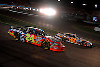 Apr 22, 2006; Phoenix, AZ, USA; Nascar Nextel Cup driver Jeff Gordon of the (24) DuPont Chevrolet Monte Carlo passes Dale Jarrett during the Subway Fresh 500 at Phoenix International Raceway. Mandatory Credit: Mark J. Rebilas-US PRESSWIRE Copyright © 2006 Mark J. Rebilas..