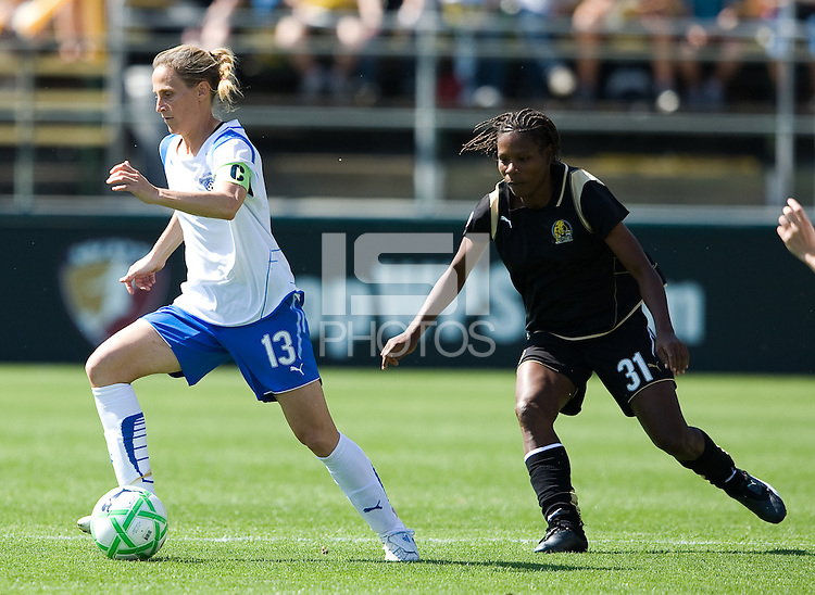 Kristine Lilly dribbles the ball away from Formiga. FC Gold Pride defeated the Boston Breakers, 2-1, in their home opener on April 5, 2009 at Buck Shaw Stadium in Santa Clara, CA.