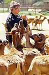 Woman feeding animals at the West Coast Game Park Bandon Oregon State USA