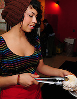 Monica Martin serves pecan sandies with chocolate chips at Mother Fool's Coffeehouse