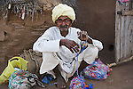 Old Rajasthani man spinning wool; man belongs to the cast of craftsmen that live in this area, Phalodi, Rajasthan, India --- Model Released