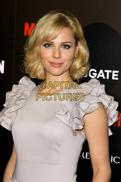 "CARA BUONO.at the Season 4 premiere of AMC's ""Mad Men"", Mann Chinese 6 Theatre. Hollywood, CA, USA, July 20th, 2010. .half length grey gray beige dress ruffles sleeve ruffle.CAP/CEL.©CelPh/Capital Pictures."
