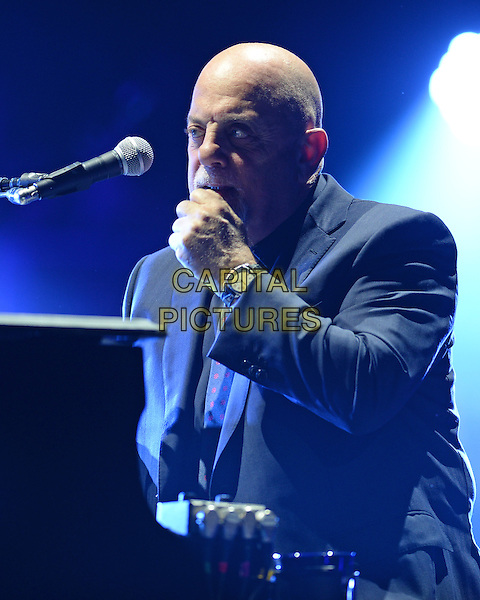 MIAMI, FL - JANUARY 31:  Billy Joel performs at the AmericanAirlines Arena on January 31, 2015 in Miami Florida. <br /> CAP/MPI/MPI04<br /> &copy;MPI04/MPI/Capital Pictures
