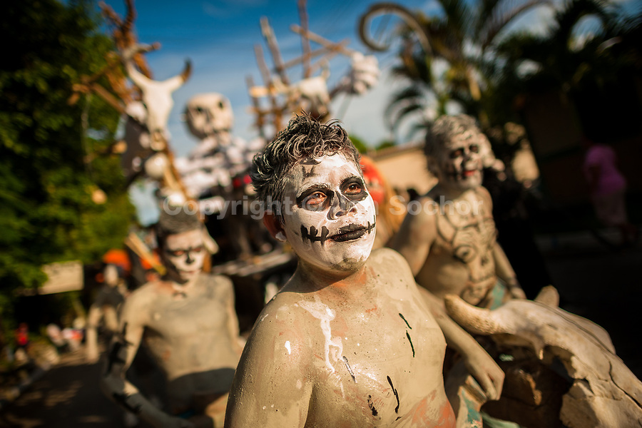 Young Salvadoran men, painted an ashen grey, perform indigenous mythology characters in the La Calabiuza parade at the Day of the Dead celebration in Tonacatepeque, El Salvador, 1 November 2016. The festival, known as La Calabiuza since the 90s of the last century, joins Salvador's pre-Hispanic heritage and the mythological figures (La Sihuanaba, El Cipitío, La Llorona etc.) collected from the whole Central American region, together with the catholic All Saints Day holiday and its tradition of honoring the dead relatives. Children and youths only, dressed up in scary costumes and carrying painted carts, march from the local cemetery to the downtown plaza where the party culminates with music, dance, drinking and eating pumpkin (Ayote) with honey.
