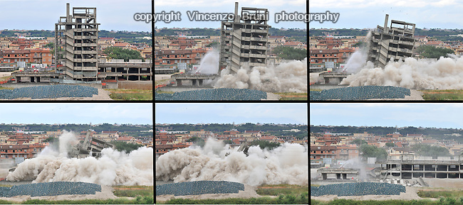 Demolition of a 1980's abandoned building in Rome, Italy on June 22, 2010.