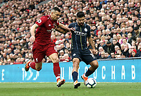Manchester City's Sergio Aguero holds off the challenge from Liverpool's Dejan Lovren<br /> <br /> Photographer Rich Linley/CameraSport<br /> <br /> The Premier League - Liverpool v Manchester City - Sunday 7th October 2018 - Anfield - Liverpool<br /> <br /> World Copyright &copy; 2018 CameraSport. All rights reserved. 43 Linden Ave. Countesthorpe. Leicester. England. LE8 5PG - Tel: +44 (0) 116 277 4147 - admin@camerasport.com - www.camerasport.com
