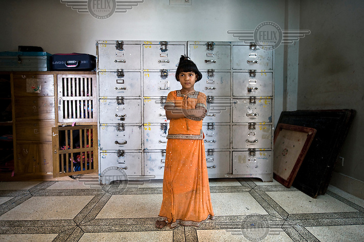 A girl stands at a shelter for girls orphaned or abandoned, run by local NGO SEEP, which is supported by the Dutch NGO Terre des Hommes. Each child has her own locker for her possesions.