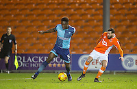 Anthony Stewart of Wycombe Wanderers with Mark Yeates of Blackpool during the The Checkatrade Trophy match between Blackpool and Wycombe Wanderers at Bloomfield Road, Blackpool, England on 10 January 2017. Photo by Andy Rowland / PRiME Media Images.
