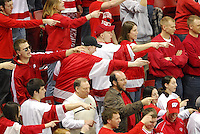 Adults join students in celebrating as the Badger men's hockey team beats Denver 6:2 at the Kohl Center in Madison, Wisconsin Saturday night, 3/29/08. The Badgers will play North Dakota on Sunday in the final game of the NCAA Midwest Rational hockey championship tournament.