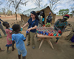 Heydi Foster, the CEO of Mision Cara, distributes food to children in the Kaya Refugee Camp in Maban County, South Sudan. The county is host to more than 130,000 refugees from the Blue Nile region of Sudan, and Misean Cara has supported Jesuit Refugee Service as it provides educational and psycho-social services to both refugees and the host community.