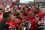 The University of Louisville Cardinal football team celebrates after winning the Governor's Cup on Sunday, Sept. 2, 2012 in Papa John's Stadium in Louisville, Ky. Louisville won 32-14. Photo by Latara Appleby | Staff