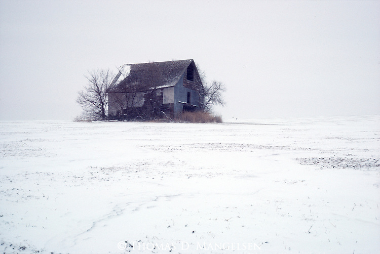 A neglected barn in Nebraska on a cold January day.