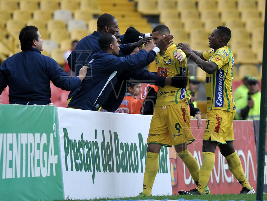 BOGOTA - COLOMBIA -10 -11-2013: Los jugadores de Atletico Huila, celebran el gol anotado durante del partido por la fecha 18 de la Liga Postobon II-2013, jugado en el estadio Nemesio Camacho El Campin de la ciudad de Bogota.  / The players of Atletico Huila celebrate the goal scored during a match for the 18 date of the Postobon Leaguje II-2013 at the Nemesio Camacho El Campin Stadium in Bogota city, Photo: VizzorImage  / Luis Ramirez / Staff.