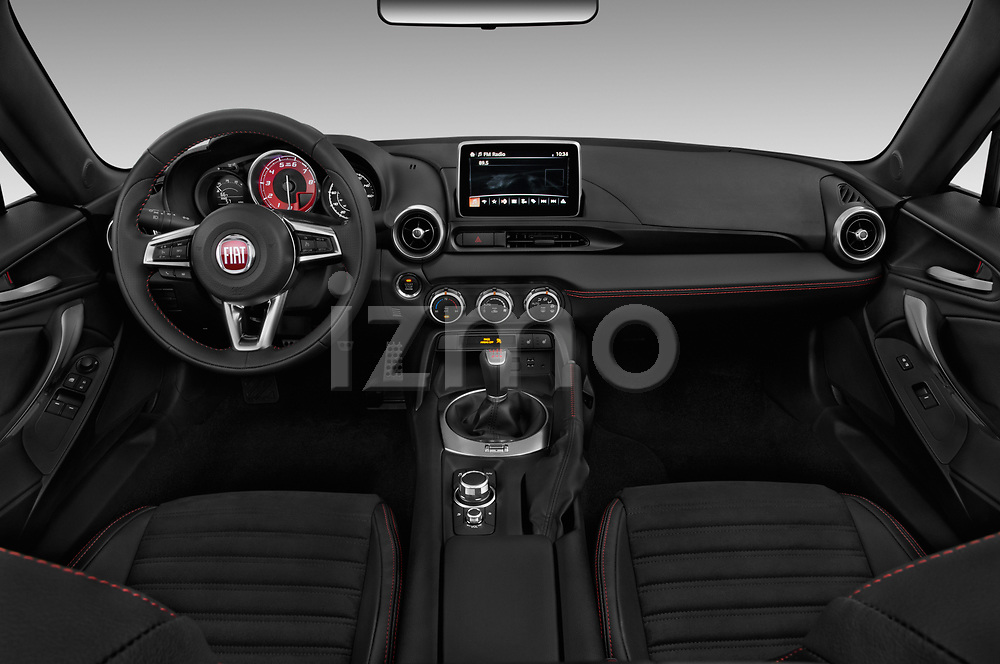 Stock photo of straight dashboard view of 2018 Fiat 124-Spider Abarth 2 Door Convertible Dashboard