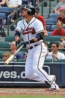 Atlanta Braves second baseman Martin Prado #1 swings at a pitch during a game against the Colorado Rockies at Turner Field on September 3, 2012 in Atlanta, Georgia. The Braves  defeated the Rockies 6-1. (Tony Farlow/Four Seam Images).