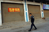 Deserted streets in Donguan, China.   As the economy changes and chinese labour gets more expensive, factories are cosing leaving ghost towns behind them.<br /> <br /> PHOTO BY RICHARD JONES