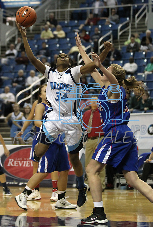 Centenial's Breanna Workman shoots over Reno defender Morgan McGwire during a semi-final game at the NIAA 4A State Basketball Championships between Centennial and Reno high schools at Lawlor Events Center in Reno, Nev, on Thursday, Feb. 23, 2012. Reno won 60-41. .Photo by Cathleen Allison