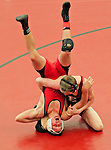 Forest Hills Eastern wrestler traps an Allendale opponent in an awkward position during a tournament in Grand Rapids, Michigan on January 23, 2010. (Photo by Bob Campbell)