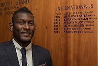 Aaron Pierre of Wycombe Wanderers poses next to the International board at the club with his name added following his first 2 appearances for Grenada in the past week during the Sky Bet League 2 match between Wycombe Wanderers and Plymouth Argyle at Adams Park, High Wycombe, England on 12 September 2015. Photo by Andy Rowland.