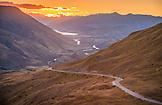 NEW ZEALAND, Queenstown, Sunset over the Crown Range Road, Ben M Thomas