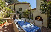 BNPS.co.uk (01202 558833)<br /> Pic: JimBartsch/DouglasElliman<br /> <br /> Outdoor living space...<br /> <br /> Goddesses and Monsters - Hacienda Style home from the halcyon days of Hollywood for sale.<br /> <br /> The enchanting former Beverly Hills home of both film icon Katharine Hepburn, and screen monster Boris Karloff has emerged on the market for £7million. ($8,95m)<br /> <br /> The four-time Oscar winning starlet lived at the 'hacienda' home when she first moved to Hollywood in the early 1930s.<br /> <br /> After finding fame, she sold it to Frankenstein actor Boris Karloff in the mid-1940s who bizarrely was a keen gardener and worked extensively on the landscaping.<br /> <br /> Another famous former owner of the single storey, five bedroom Spanish style residence, which has its own swimming pool and bar, is Animals frontman Eric Burdon, whose House of the Rising Sun, help fund its purchase in the 1960's.<br /> <br /> It is being sold with estate agent Douglas Elliman who describe it as 'a home fit for Hollywood royalty'.