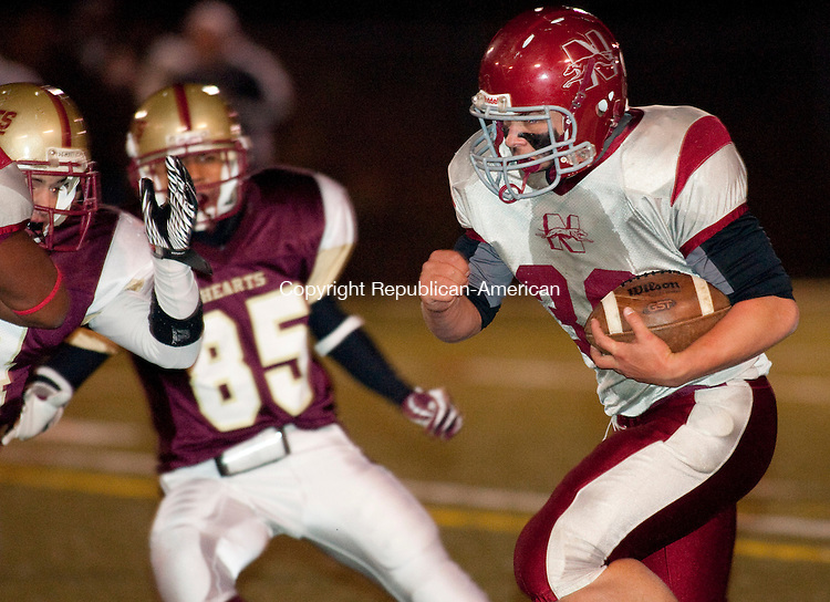 WATERBURY, CT, 22 OCTOBER 2010-102210JS08-Naugatuck's Jake Yourison (38) runs in for a 12-yard touchdown run during their game against Sacred Heart Friday at Municipal Stadium in Waterbury. <br />  Jim Shannon Republican-American