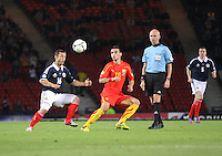 Shaun Maloney and Nikola Gligorov watching the ball as referee Sergey Karasev watches in the Scotland v Macedonia FIFA World Cup Qualifying match at Hampden Park, Glasgow on 11.9.12.