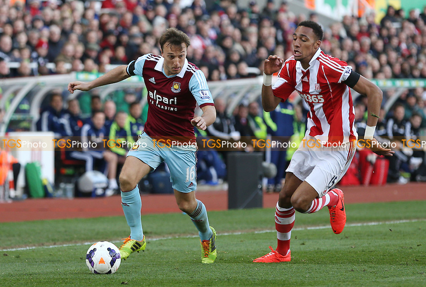 Mark Noble of West Ham and Steven Nzonzi of Stoke - Stoke City vs West Ham United, Barclays Premier League at the Britannia Stadium, Stoke - 15/03/14 - MANDATORY CREDIT: Rob Newell/TGSPHOTO - Self billing applies where appropriate - 0845 094 6026 - contact@tgsphoto.co.uk - NO UNPAID USE