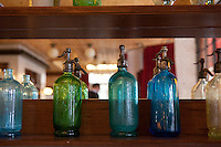 Vintage siphon bottles decorate the wall at Bouchon restaurant, Monaco, 23 March 2012