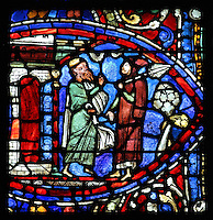 The older son returns from the field, spade on his shoulder, and his father explains why they should rejoice and celebrate the return of his brother, from the Parable of the Prodigal Son stained glass window, in the north transept of Chartres Cathedral, Eure-et-Loir, France. This window follows the parable as told by St Luke in his gospel. It is thought to have been donated by courtesans, who feature in 11 of the 30 sections. Chartres cathedral was built 1194-1250 and is a fine example of Gothic architecture. Most of its windows date from 1205-40 although a few earlier 12th century examples are also intact. It was declared a UNESCO World Heritage Site in 1979. Picture by Manuel Cohen