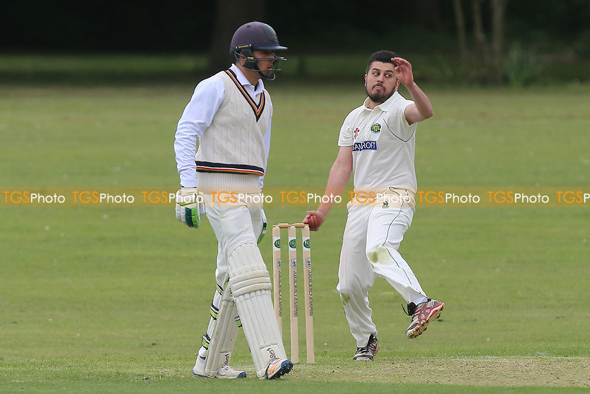 W Shafique in bowling action for Harold Wood during Harold Wood CC vs Ilford CC, Shepherd Neame Essex League Cricket at Harold Wood Park on 29th April 2017