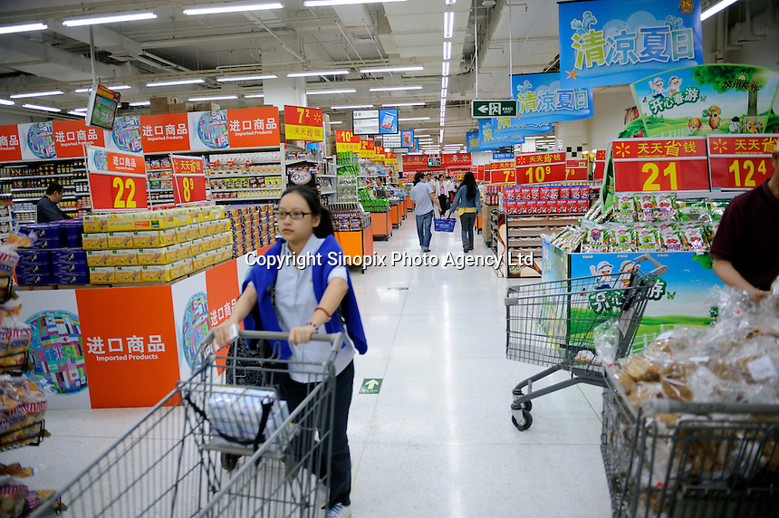 Chinese customers shopping in WalMart supermarket in Beijing, China. Walmart Stores, Inc. was founded by American retail. As of August 5, 2010, Walmart had 189 units in 101 cities in China..22 May 2011