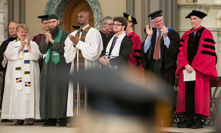 Faculty and staff applaud the graduates as the DePaul community gathered at the Saint Vincent de Paul Parish Church on DePaul University's Lincoln Park Campus to participate in a Baccalaureate Mass Friday, June 10, 2016. The event was part of the 118th commencement ceremonies for the Chicago university. (DePaul University/Jamie Moncrief)