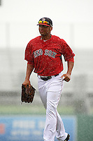 GCL Red Sox outfielder Tyler Hill (34) jogs off the field after the game was put under delay against the GCL Rays on August 3, 2015 at the JetBlue Park at Fenway South in Fort Myers, Florida.  The game was suspended after two innings due to the inclement weather.  (Mike Janes/Four Seam Images)