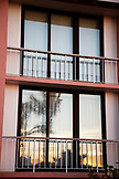 BERMUDA. Hamilton. Balcony doors with reflection of the sunset at the Hamilton Princess & Beach Club Hotel.