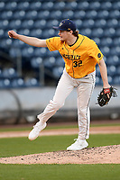 Starting pitcher Cedric Gillette (32) of the Merrimack Warriors delivers a pitch in a game against the Michigan State Spartans on Saturday, February 22, 2020, at Fluor Field at the West End in Greenville, South Carolina. Merrimack won, 7-5. (Tom Priddy/Four Seam Images)